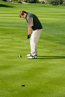 Golfer Putting for Birdie