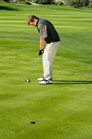 Golfer Putting for Birdie