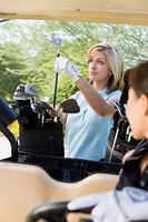 Golfer Selecting Club
