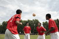 Soccer Players Practice Heading the Ball