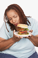 Overweight Woman with Junk Food