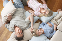 Father and Children Lying on Floor