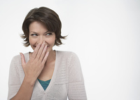Woman Covering Mouth with Hand