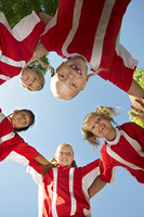 Five children soccer players (7-9 years) huddling  view from below  portrait
