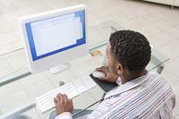 Young Man Using Desktop Computer