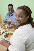 Overweight mid-adult couple having healthy meal