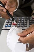 Accountant Reading Adding Machine Tape