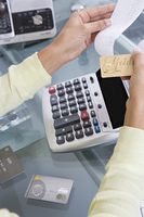 Woman Adding up Credit Card Charges