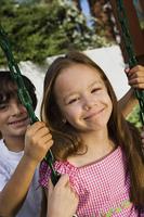 Little Boy Swinging Girl