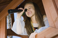 Little Girl Playing in a Fort