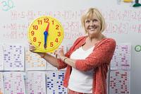 Teacher Showing Class a Clock