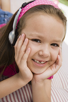 Little Girl Listening to Headphones