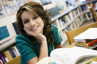 High School Student in Library