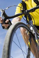 Senior man cycling, low angle view of bike