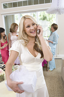 Bride using mobile phone during bridal shower