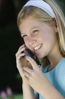 Girl with mobile phone, smiling