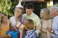 Mid-adult woman receiving birthday presents