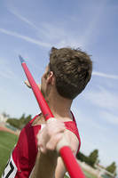 Male athlete throwing javelin