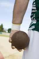 Male shot putter holding shot, close-up view