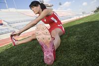 Female athlete stretching