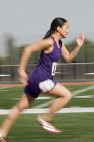 Female track athlete sprinting