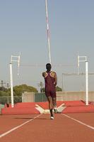 Female athlete preparing for pole jump
