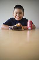 Portrait of pre-teen (10-12) boy about to eat dessert