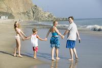 Family walking on beach