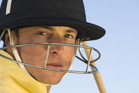 Polo player wearing helmet, close-up, portrait