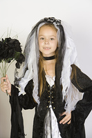 Portrait of girl (7-9) wearing Halloween costume