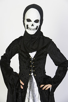 Portrait of child (7-9) wearing skeleton costume