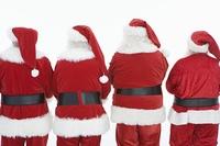 Group of men dressed as Santa Claus, rear view
