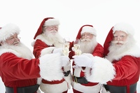 Group of men dressed as Santa Claus toasting champagne