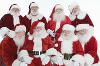 Group of men dressed as Santa Claus, portrait