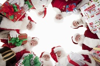 Group of men dressed as Santa Claus, looking down, low angle view