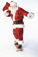Santa Claus on skateboard carrying sack