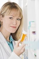 Female pharmacist working in pharmacy