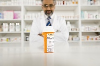 Prescription drugs and male pharmacist