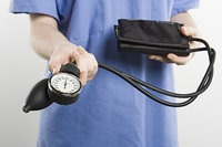 Surgeon with blood pressure gauge, mid section