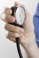 Surgeon with blood pressure gauge, close up
