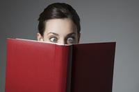 Cross-eyed Brunette and red book cover