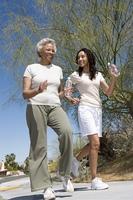 Mother and daughter jog together