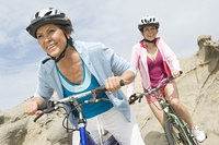 Mature and mid adult women compete on a cycle ride