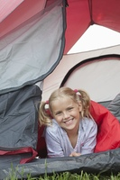Girl smiles from tent