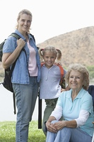 Mother daughter and grand-daughter camping holiday portrait
