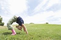 Bending over backwards girl on grass