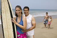 Family with Surfboard on Beach