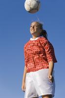 Teenage Soccer Player Heading Ball