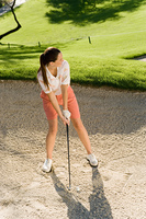 Golfer Preparing to Hit Ball in Sand Trap