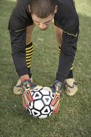 Soccer Goalie Setting Down the Ball